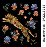 leopard with flowers. vector...   Shutterstock .eps vector #692218318