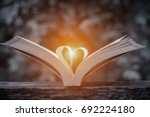 pages of a book curved into a... | Shutterstock . vector #692224180