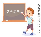 happy boy is standing by the... | Shutterstock .eps vector #692228563
