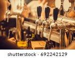 beer tap with fresh brewed... | Shutterstock . vector #692242129