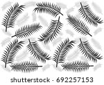 palm leaves background. | Shutterstock .eps vector #692257153