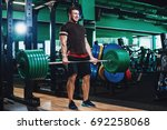young powerful muscular... | Shutterstock . vector #692258068