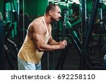 exercise for triceps in the gym | Shutterstock . vector #692258110