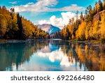 xinjiang kanas river scenery | Shutterstock . vector #692266480