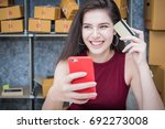 calculating the cost of postage ... | Shutterstock . vector #692273008
