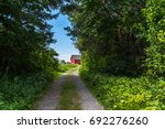 trail covered with grass and...   Shutterstock . vector #692276260