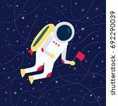 cartoon cosmonaut with a flag... | Shutterstock .eps vector #692290039