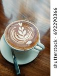hot coffee on the wooden table... | Shutterstock . vector #692290366