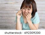 woman who is talking on a smart ... | Shutterstock . vector #692309200