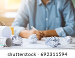 close up of crumpled paper on... | Shutterstock . vector #692311594