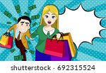 happy couple on a shopping... | Shutterstock .eps vector #692315524