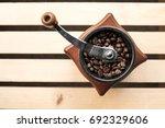 vintage manual coffee grinder... | Shutterstock . vector #692329606
