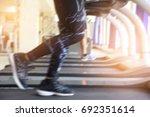 women are running on a... | Shutterstock . vector #692351614