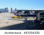 Small photo of A view from the waiting room on the airfield at Vnukovo International Airport (Moscow) - July 2017.
