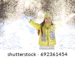 happy winter fun woman playing... | Shutterstock . vector #692361454