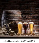 glasses of beer and ale barrel... | Shutterstock . vector #692362819