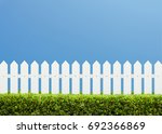 white wooden fence and green... | Shutterstock . vector #692366869