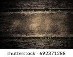 dark brown and black wooden... | Shutterstock . vector #692371288
