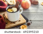 hot drink of apple tea with... | Shutterstock . vector #692395210