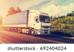 big white truck on the road in... | Shutterstock . vector #692404024