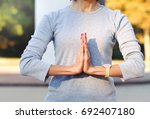 close up of body woman doing... | Shutterstock . vector #692407180