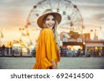 beautiful exited smiling... | Shutterstock . vector #692414500