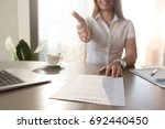 smiling businesswoman proposes... | Shutterstock . vector #692440450