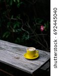 a cup of coffee on the table. | Shutterstock . vector #692445040
