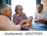 smiling senior woman showing... | Shutterstock . vector #692477059