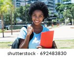 laughing african american...   Shutterstock . vector #692483830