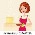 beautiful housewife cooking  | Shutterstock . vector #692488210