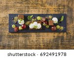 beautiful and tasty food on a... | Shutterstock . vector #692491978