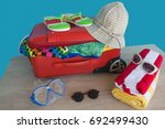 opened traveler case  suitcase... | Shutterstock . vector #692499430