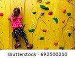 little girl in a pink t shirt... | Shutterstock . vector #692500210