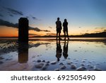 silhouette young couple enjoy... | Shutterstock . vector #692505490