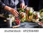 pickled vegetables in jars... | Shutterstock . vector #692506480