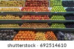 organized fruit stand showing... | Shutterstock . vector #692514610