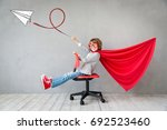superhero child. kid pretend to ... | Shutterstock . vector #692523460