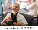 portrait of smiling senior man... | Shutterstock . vector #692525113