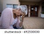side view of depressed senior... | Shutterstock . vector #692530030