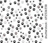 paw print seamless. traces of... | Shutterstock .eps vector #692536558