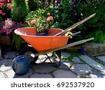 Orange Wheel Barrow And Tools...