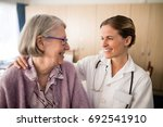 smiling female doctor looking... | Shutterstock . vector #692541910