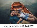 young couple in love sitting in ... | Shutterstock . vector #692544670