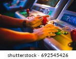 detail on hands with arcade... | Shutterstock . vector #692545426