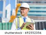 senior engineer man in suit and ... | Shutterstock . vector #692552356