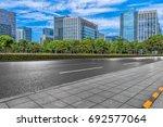empty asphalt road front of... | Shutterstock . vector #692577064