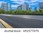 empty asphalt road front of... | Shutterstock . vector #692577070