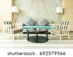 modern living room design with... | Shutterstock . vector #692579566