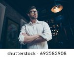 low angle photo of a confident... | Shutterstock . vector #692582908